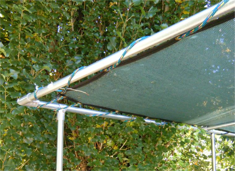 Green 60 Knit Shade Panel Installed With Rope On Fencing Top Rail Pipe Frame Trellis