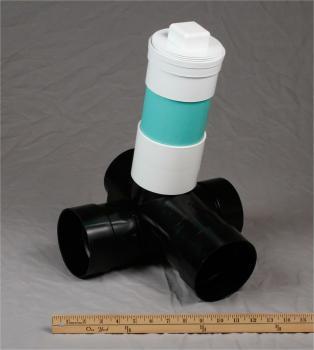 Flow director valve tee splits effluent 50/50 or can direct
